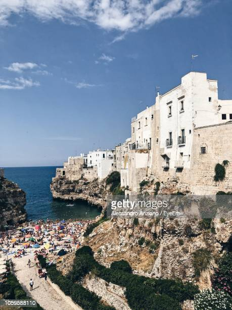 view of sea and buildings in city - polignano a mare stock photos and pictures