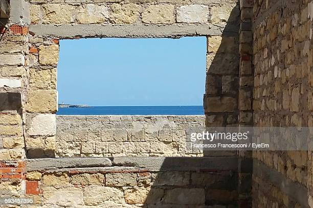 View Of Sea And Clear Sky Seen From Old Building Window