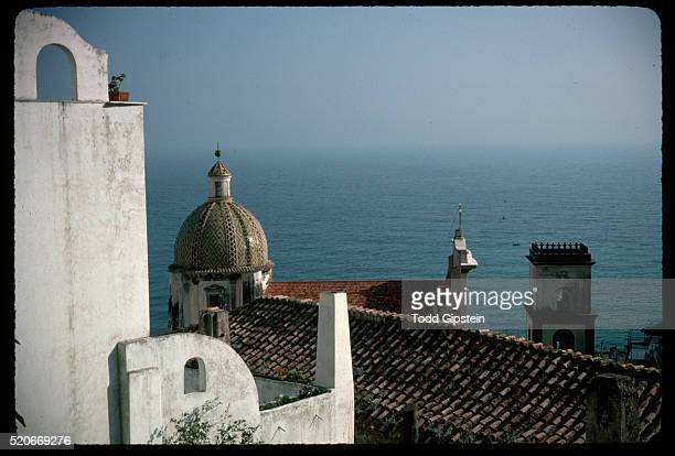 view of sea over church - gipstein stock pictures, royalty-free photos & images
