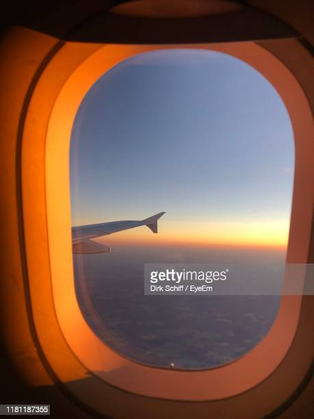 view of sea seen through airplane window - schiff stock photos and pictures