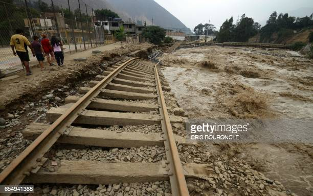 TOPSHOT View of sections of the central railroad track that follows the Rimac River which suffered severe damage by rising water and flash foods in...