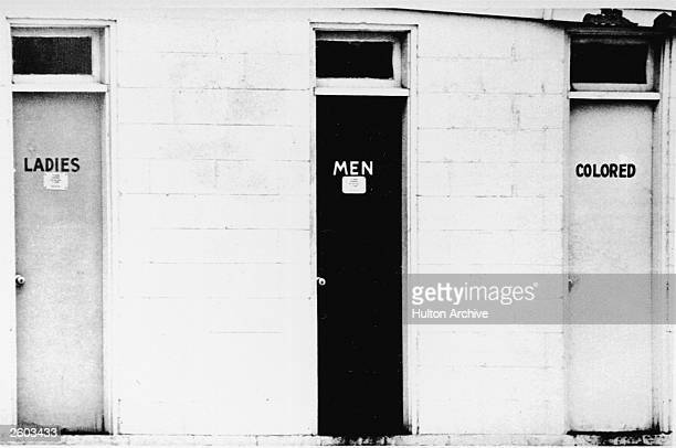 View of segregated public restrooms labelled 'ladies,' 'men' and 'colored,' USA, circa 1960.