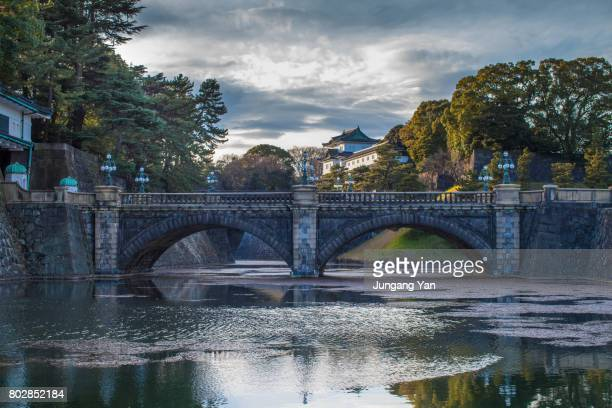 a view of seimon ishibashi stone bridge - imperial palace tokyo stock photos and pictures
