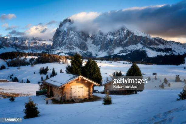 a view of seiser alm in winter, dolomite, italy - hut stock pictures, royalty-free photos & images