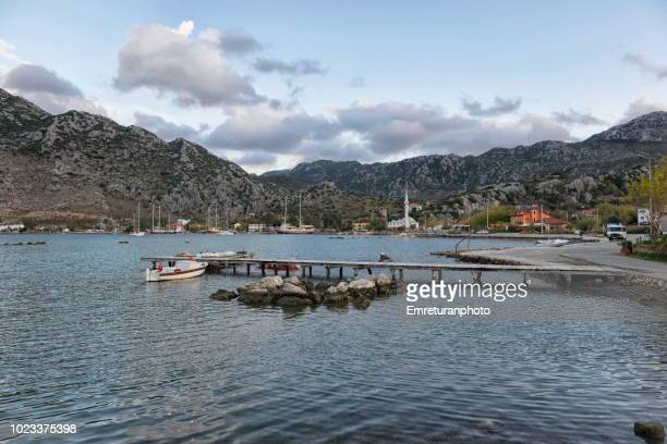 view of selimiye bay and village in winter. - emreturanphoto stock pictures, royalty-free photos & images