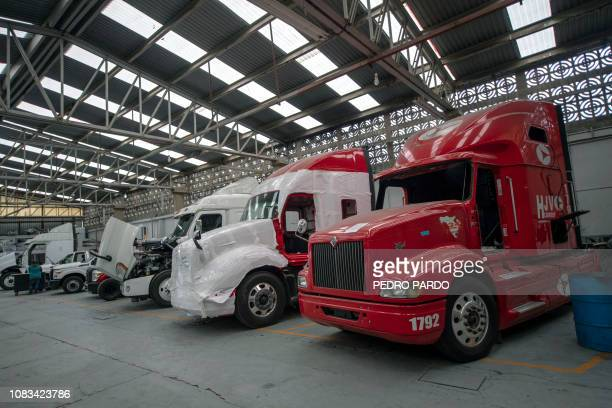 View of semi trailer trucks under armouring process at a plant in Ecatepec Mexico state on October 23 2018 In a technological race with powerful drug...