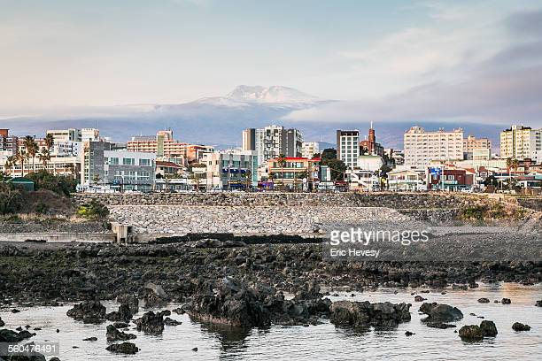 view of seogwipo city and mt hallasan, jeju island - hallasan stock photos and pictures