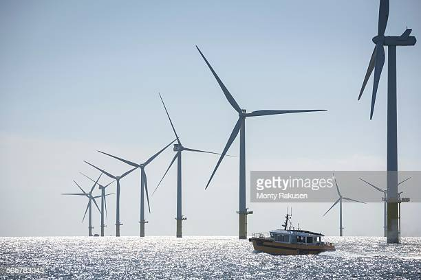 view of service boat at offshore windfarm - lincolnshire stock pictures, royalty-free photos & images
