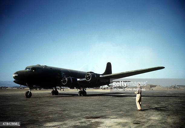A view of servicemen and a transporter aircraft at a US Base in Algiers Algeria