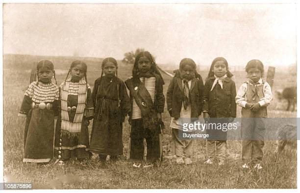 View of seven Native American children of uneducated parents before they attend school at the Hampton Institute Hampton VA 1899