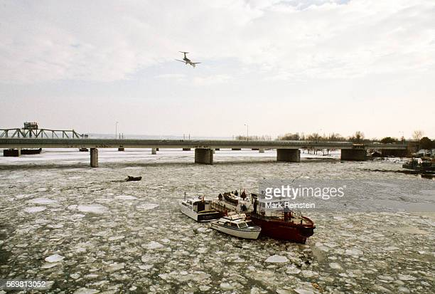 View of several vessels among them the US Coast Guard tugboat Capstan in the Potomac River to aid in the salvage of Air Florida Flight 90 Washington...