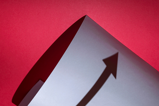 View of shadow of arrow shape with blue paper - gettyimageskorea