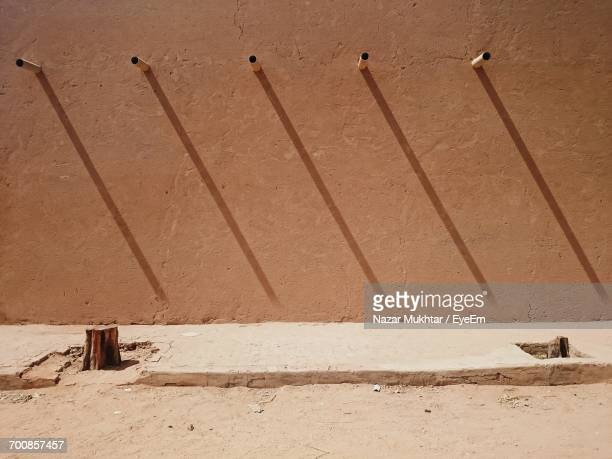 view of shadows on wall - nazar stock photos and pictures