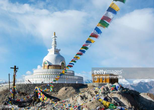 view of shanti stupa in leh ladakh with colorful omani prayer flag - nepali flag stock pictures, royalty-free photos & images