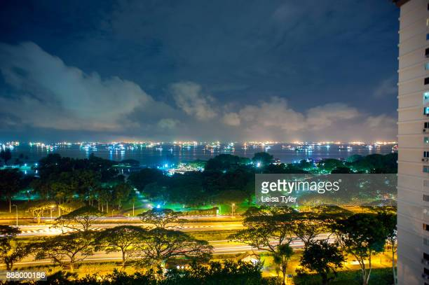 A view of ships in the harbour and the highway to Changi Airport from an apartment on Marina Parade in Singapore