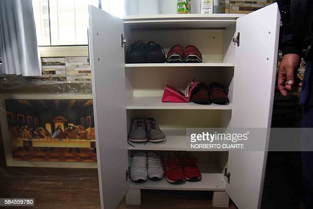 View of shoes at Brazilian drug trafficker Jarvis Chimenes Pavao's cell at Tacumbu prison in Asuncion on July 28 2016 Three rooms a plasma TV a...