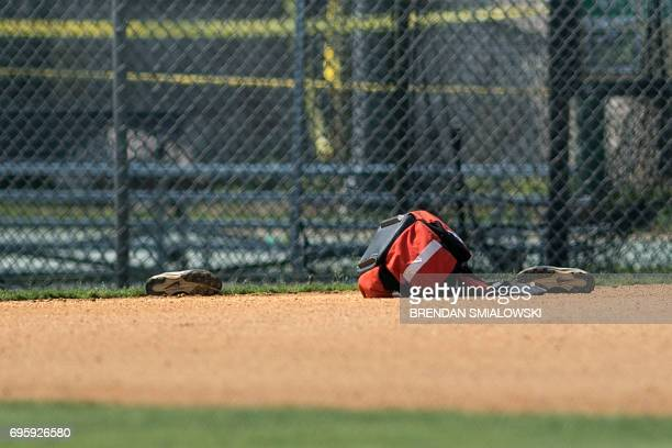 A view of shoes left at a baseball field after a shooting during a practice of the Republican congressional baseball at Eugene Simpson Statium Park...