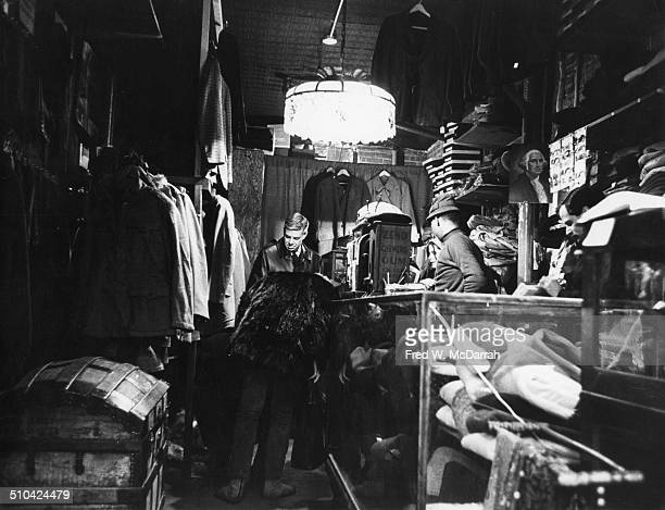 View of shoppers in Limbo an Army and Navy surplus goods shop on St Marks Place New York New York late 1960s