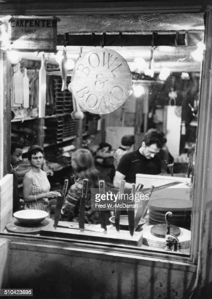View of shoppers inside the Bowl and Board kitchen supplies shop on St Marks Place New York New York May 31 1966
