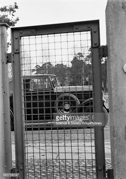 View of side of car behind metal gate Photograph by Zoltan Glass c1930 View of side of car behind metal gate Photograph taken for advertisement...
