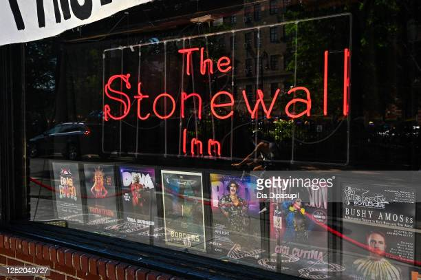 View of signage in the front window of The Stonewall Inn on Christopher Street in the West Village on June 23, 2020 in New York City. Pride Week in...