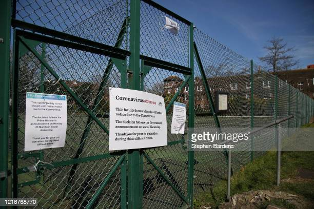A view of signage notifying that public tennis courts are closed in a local park on April 04 2020 in Brighton England The Coronavirus pandemic has...