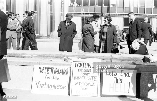 View of signs outside the Time Life Building during the Moratorium to End the War in Vietnam demonstration New York New York October 15 1969 The...