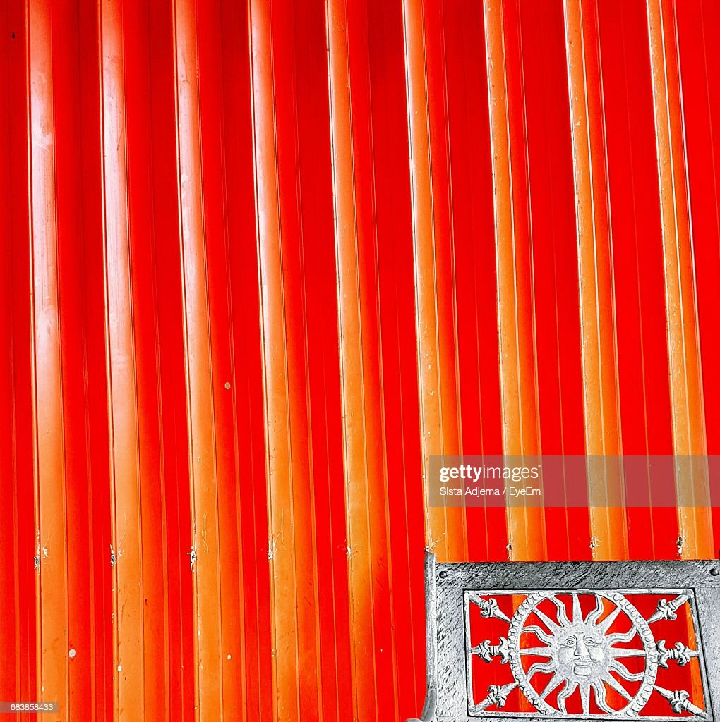 View Of Silver Colored Frame Next To Red Wall Stock Photo | Getty Images
