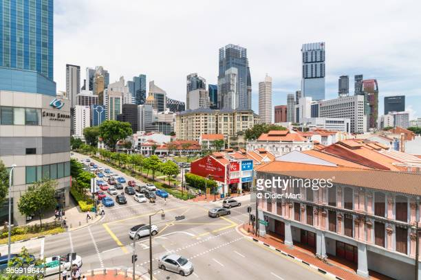 A view of Singapore Chinatown district with its colonial architecture and the business district skyline