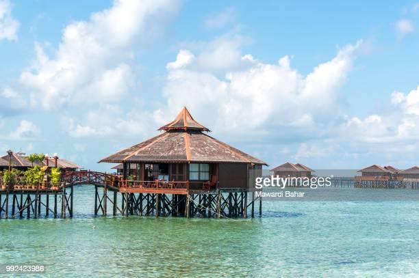 view of sipadan water village resort at mabul island. - mabul island stock photos and pictures