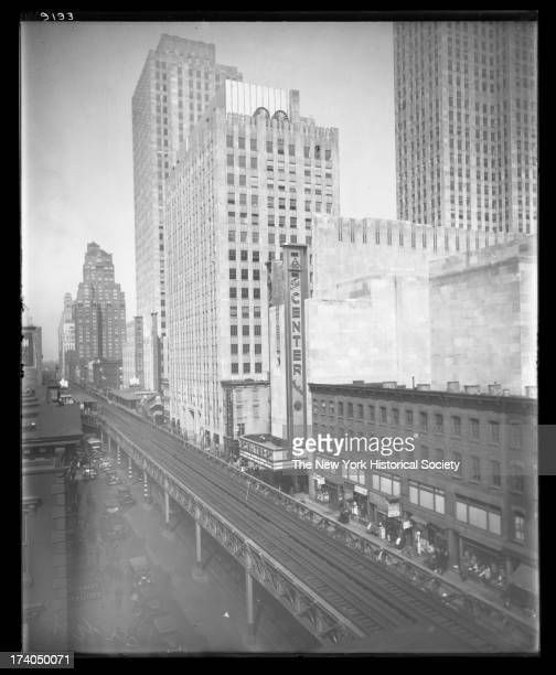 View of Sixth Avenue north from 48th Street including partial view of Rockefeller Center the Center Theatre and Radio City Music Hall and elevated...
