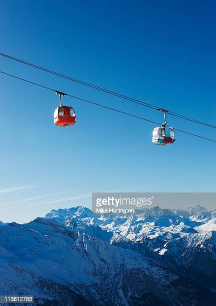 view of ski lifts over la plagne mountains - la plagne stock photos and pictures