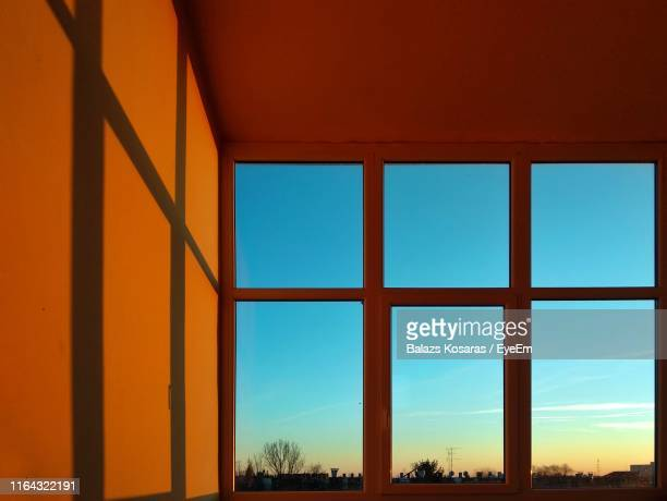 view of sky seen through window during sunset - photographed through window stock pictures, royalty-free photos & images