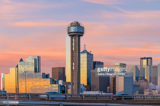 view of skyscrapers against cloudy sky - trinity river texas stock pictures, royalty-free photos & images