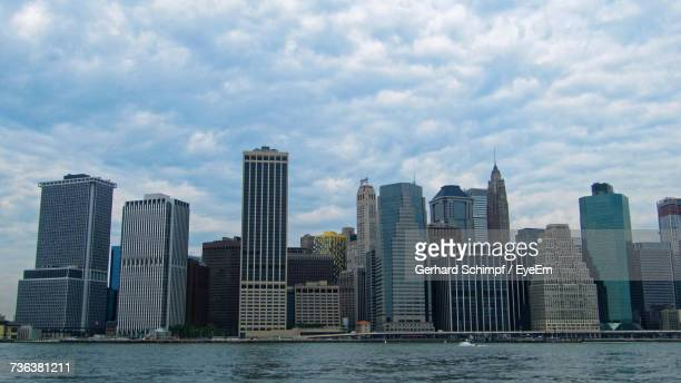 view of skyscrapers against cloudy sky - gerhard schimpf stock pictures, royalty-free photos & images