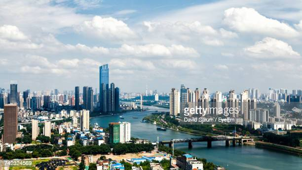 view of skyscrapers against cloudy sky - wuhan stock photos and pictures