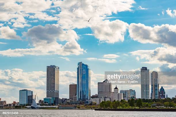 view of skyscrapers against cloudy sky - milwaukee stock pictures, royalty-free photos & images