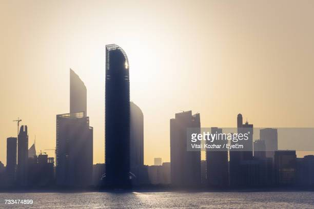 view of skyscrapers against sky during sunset - abu dhabi stock pictures, royalty-free photos & images