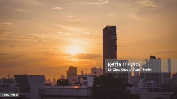 View Of Skyscrapers In City During Sunset