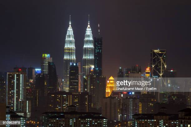 view of skyscrapers lit up at night - shaifulzamri stock pictures, royalty-free photos & images