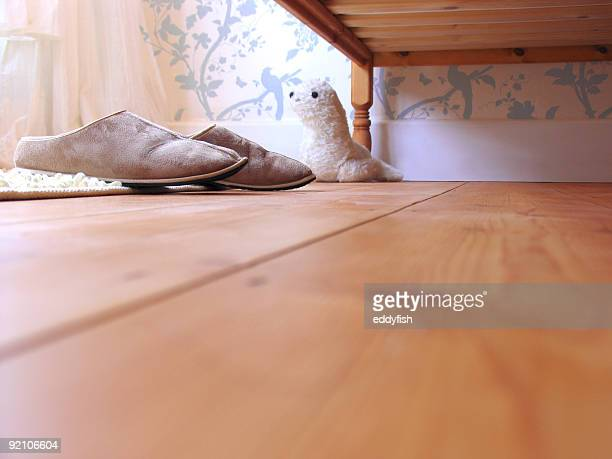 view of slippers by bedside and kids toy - floorboard stock photos and pictures
