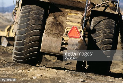 View Of Slow Moving Vehicle Sign On Tractor Stock Photo