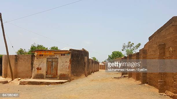 view of small hut in village against clear sky - nigeria stock pictures, royalty-free photos & images