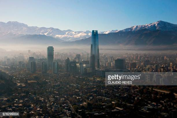 View of smog over Santiago, on June 16, 2018 due to which Chilean authorities declared a new environmental preemergence, as high levels of air...