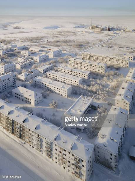 View of snow and ice covered abandoned buildings in Sementnozavodsky region, 19 kilometers from coal-mining town Vorkuta, Komi Republic, Russia on...