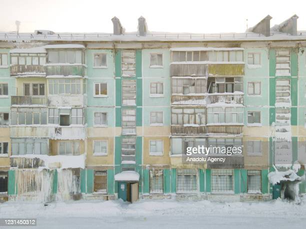 View of snow and ice covered abandoned buildings in Severny region, 17 kilometers from coal-mining town Vorkuta, Komi Republic, Russia on March 01,...