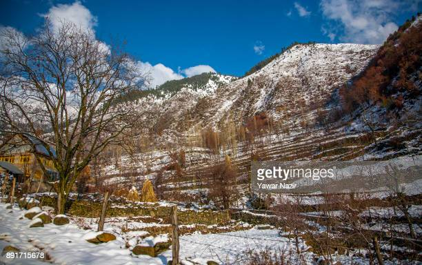 A view of snow clad mountains after seasons first snowfall on December 13 2017 In the outskirts of Srinagar the summer capital of Indian administered...