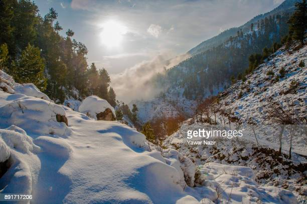 A view of snow clad mountains after seasons first snowfall on December 13 2017In the outskirts of Srinagar the summer capital of Indian administered...