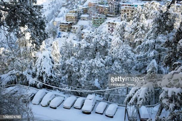 View of snow covered Sanjauli-Lakkar Bazar road, on February 8, 2019 in Shimla, India. All tourist resorts including Manali, Dalhousie, Khajiyar,...