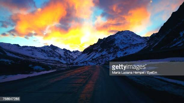 View Of Snowcapped Mountain Against Cloudy Sky During Sunset